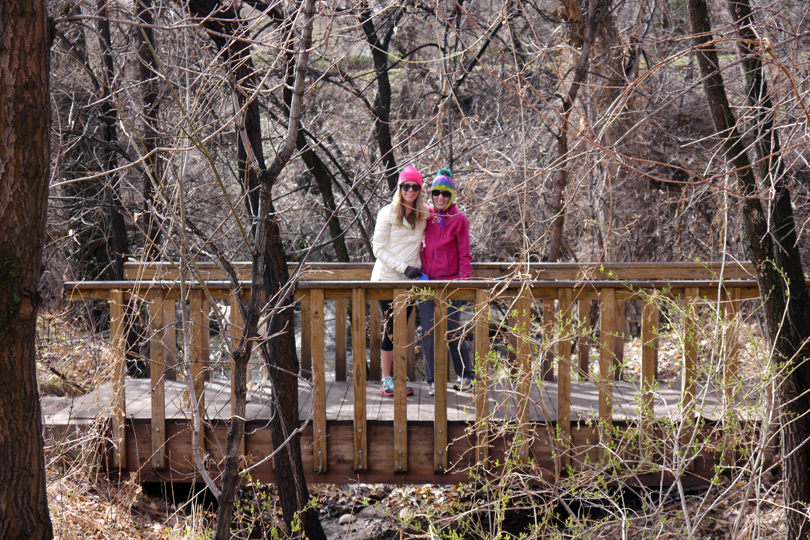 Mom and Sam posing on a cute bridge